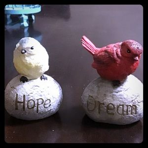 Two small inspirational bird statues